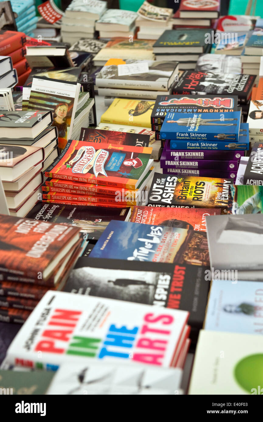 Piles of signed copies of books by festival authors in the bookshop at Hay Festival 2014 ©Jeff Morgan - Stock Image