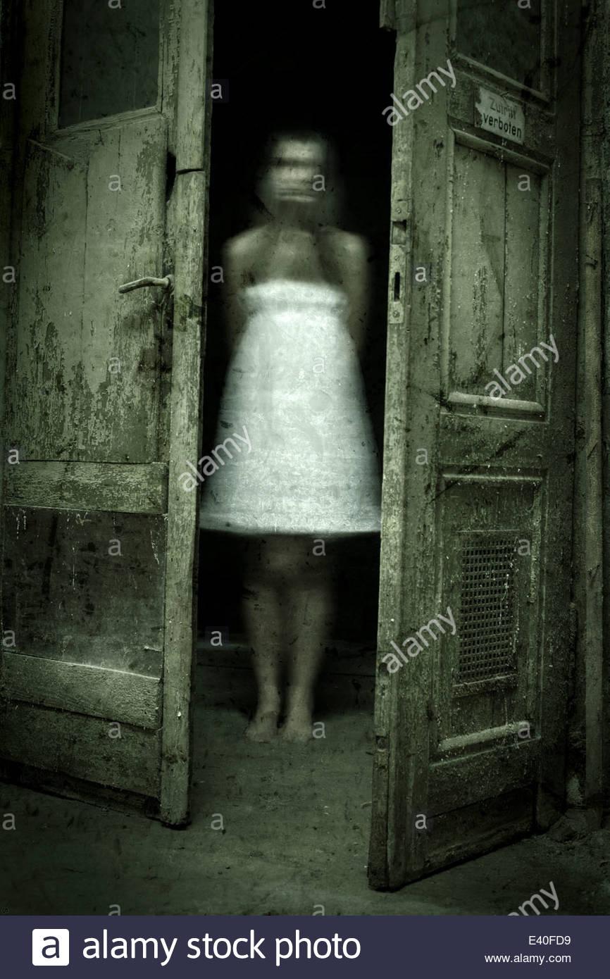 Ghost behind door & Ghost behind door Stock Photo: 71312229 - Alamy