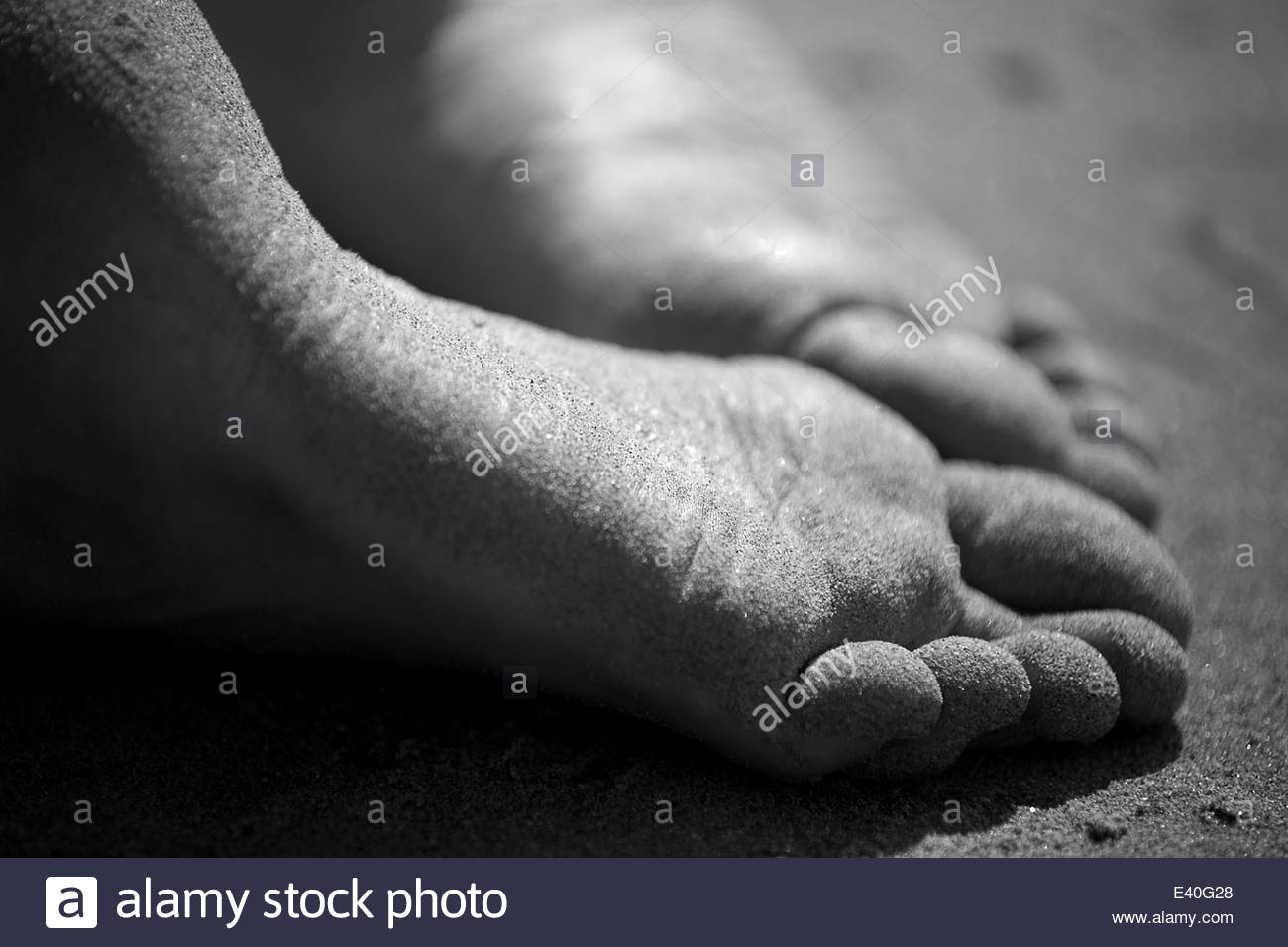 Two soles of sandy feet, close-up - Stock Image