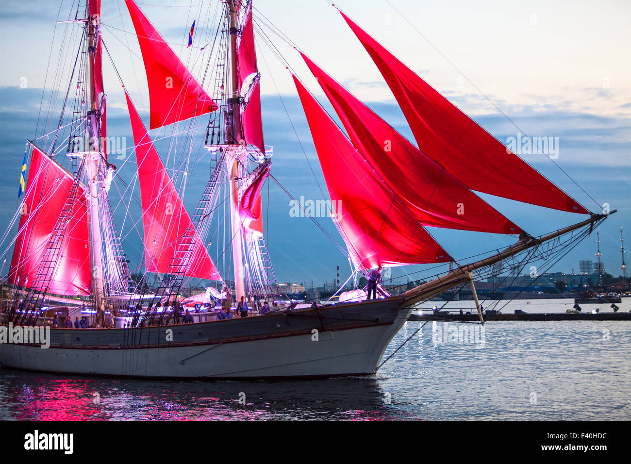 Scarlet Sails show during the White Nights Festival, St. Petersburg, Russia. Vessel with red sails on Neva river - Stock Image