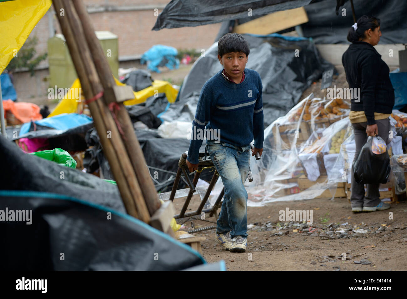 Peru, Ayacucho, Boy working as carrier at market - Stock Image