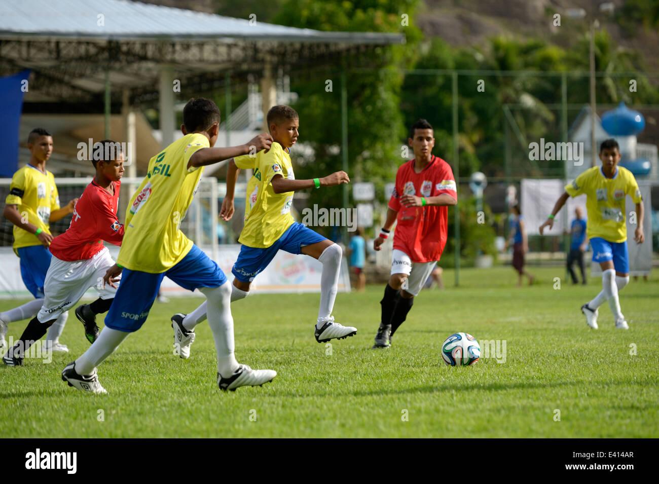 Brazil, Rio de Janeiro, Street Child World Cup 2014 football team of Egypt playing against football team of Brazil - Stock Image