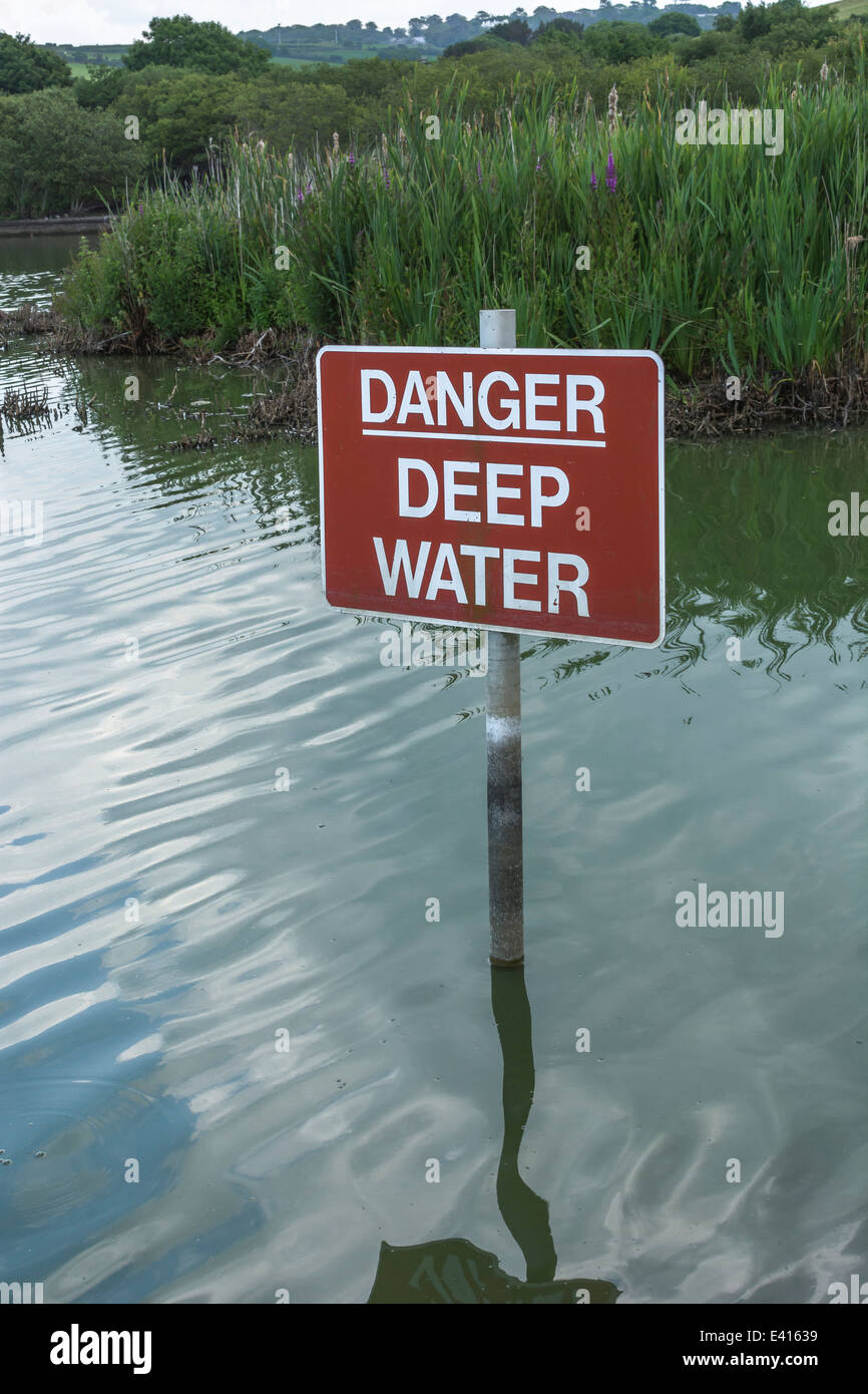 Danger warming sign for deep water. Visual metaphor for concept of financially 'staying afloat' or 'keeping - Stock Image