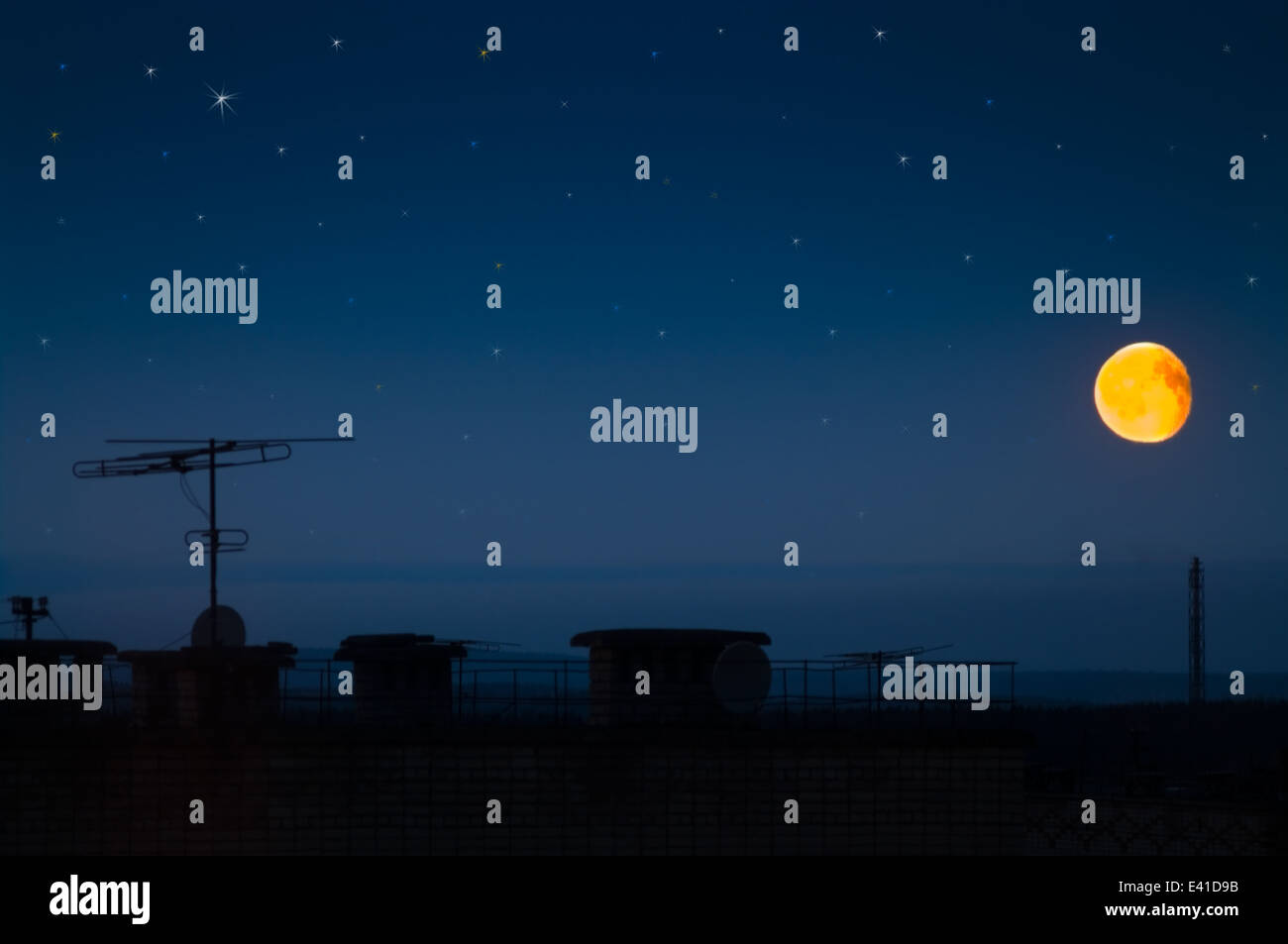 Roofs of modern buildings with moon and shine stars - Stock Image