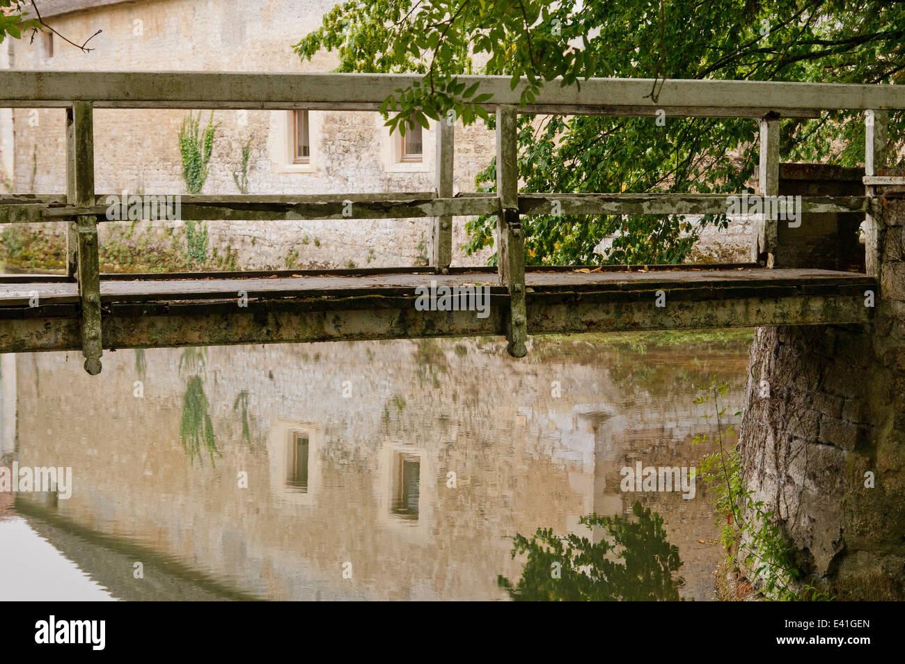 Footbridge over moat - France. - Stock Image