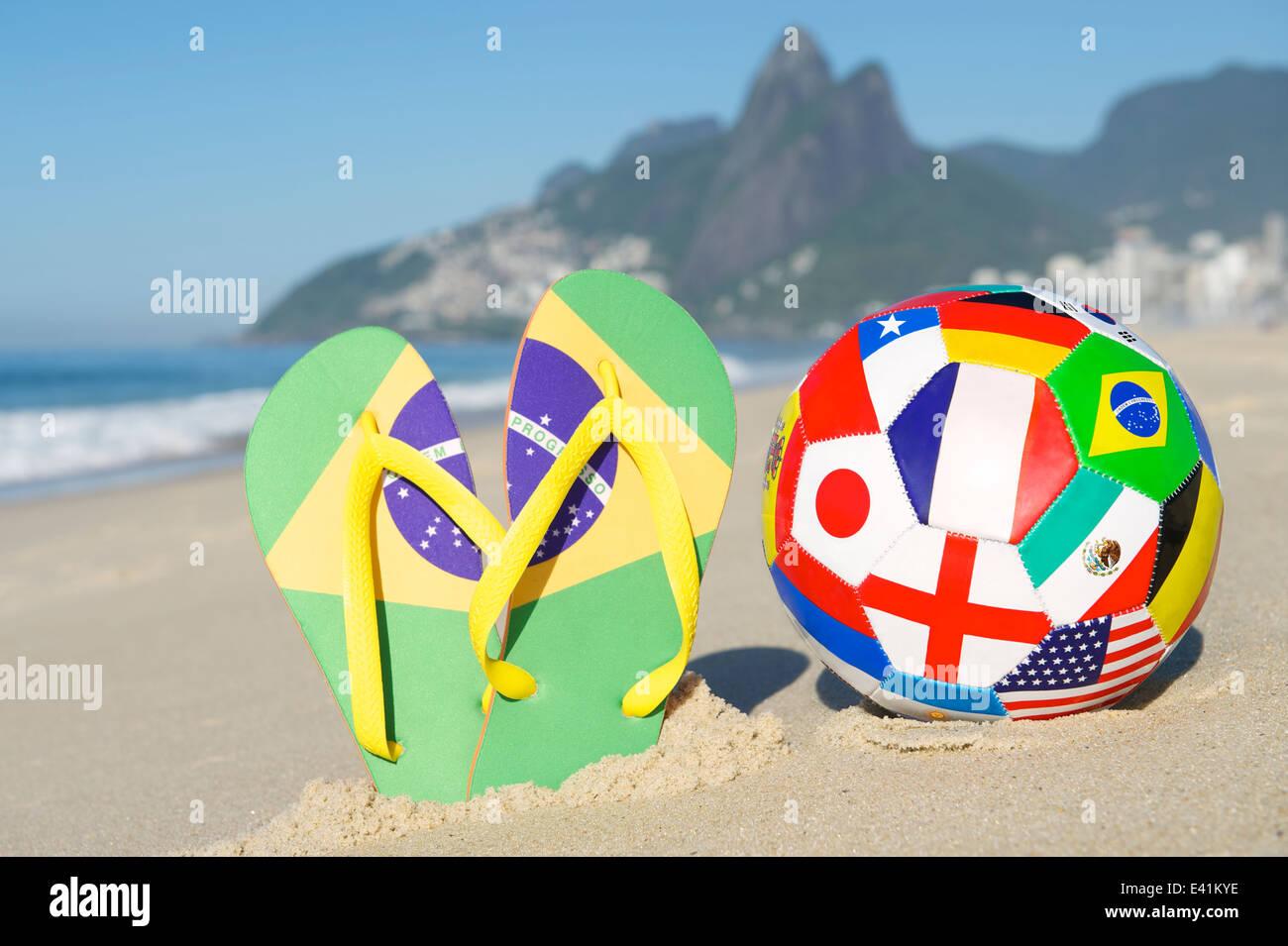 adeeb922a91 Brazilian flip flops with international flag football on Ipanema Beach Rio  de Janeiro Brazil - Stock