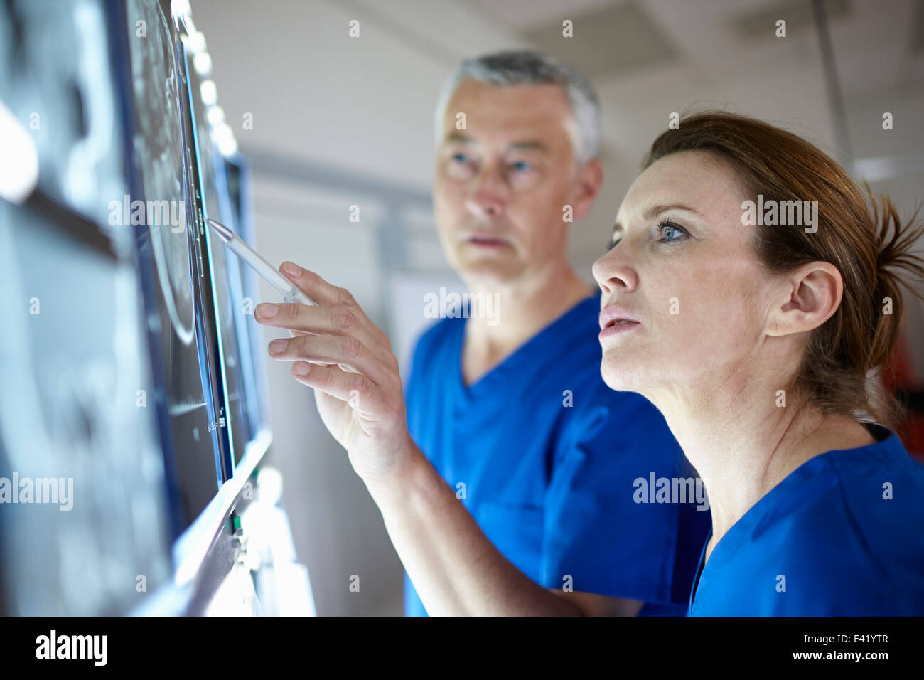 Radiologists looking at brain scans - Stock Image