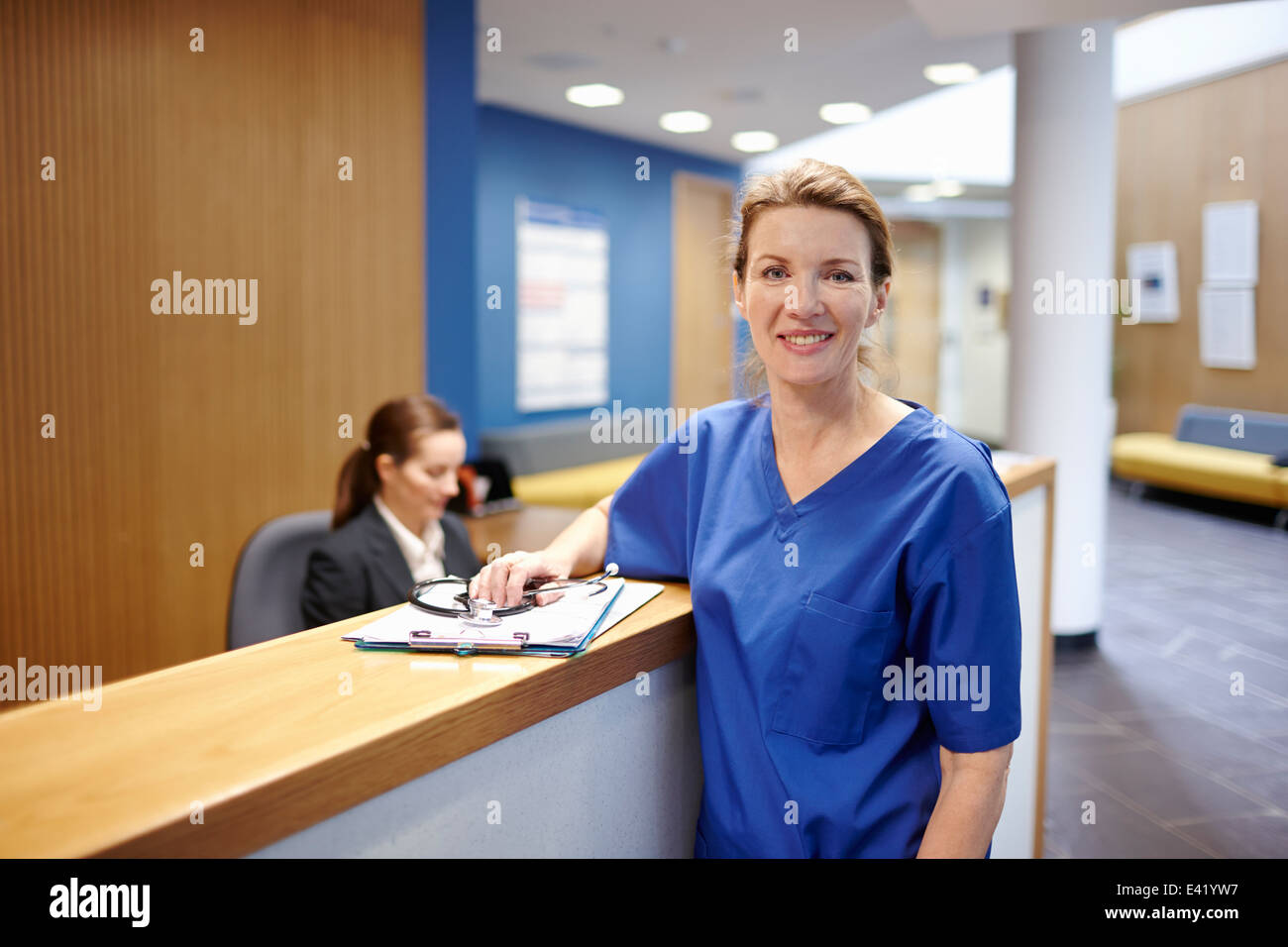 Nurse standing in hospital waiting room - Stock Image