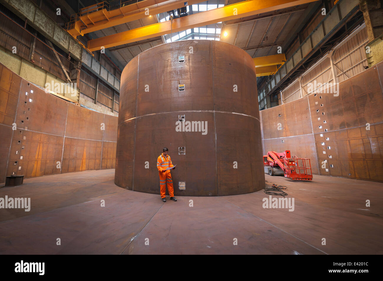 Engineer inspecting marine fabrication used for cable laying - Stock Image