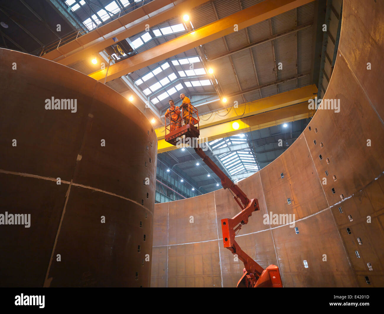 Engineers on high lift inspecting marine fabrication used for cable laying - Stock Image