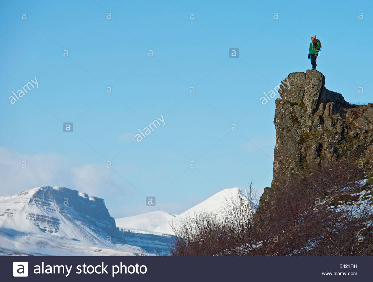 Climber on top of cliff, Baulur, West Iceland - Stock Image