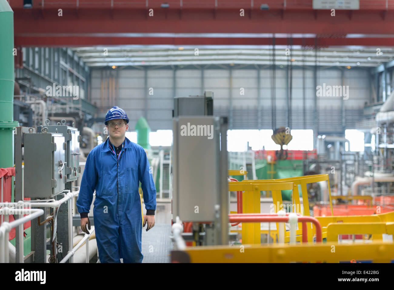 Engineer on walkway during power station outage - Stock Image