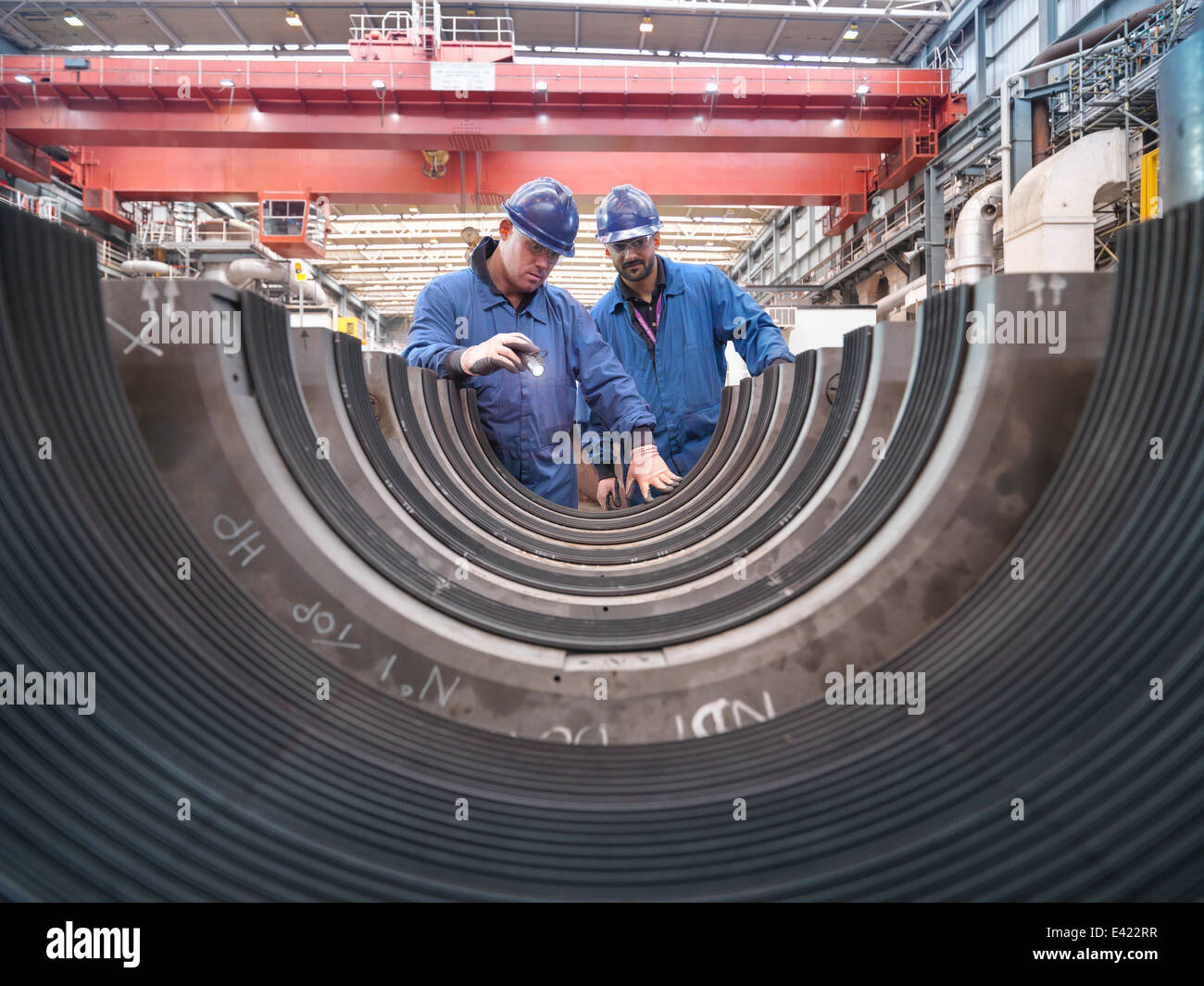 Engineers inspecting turbine housing during power station outage - Stock Image