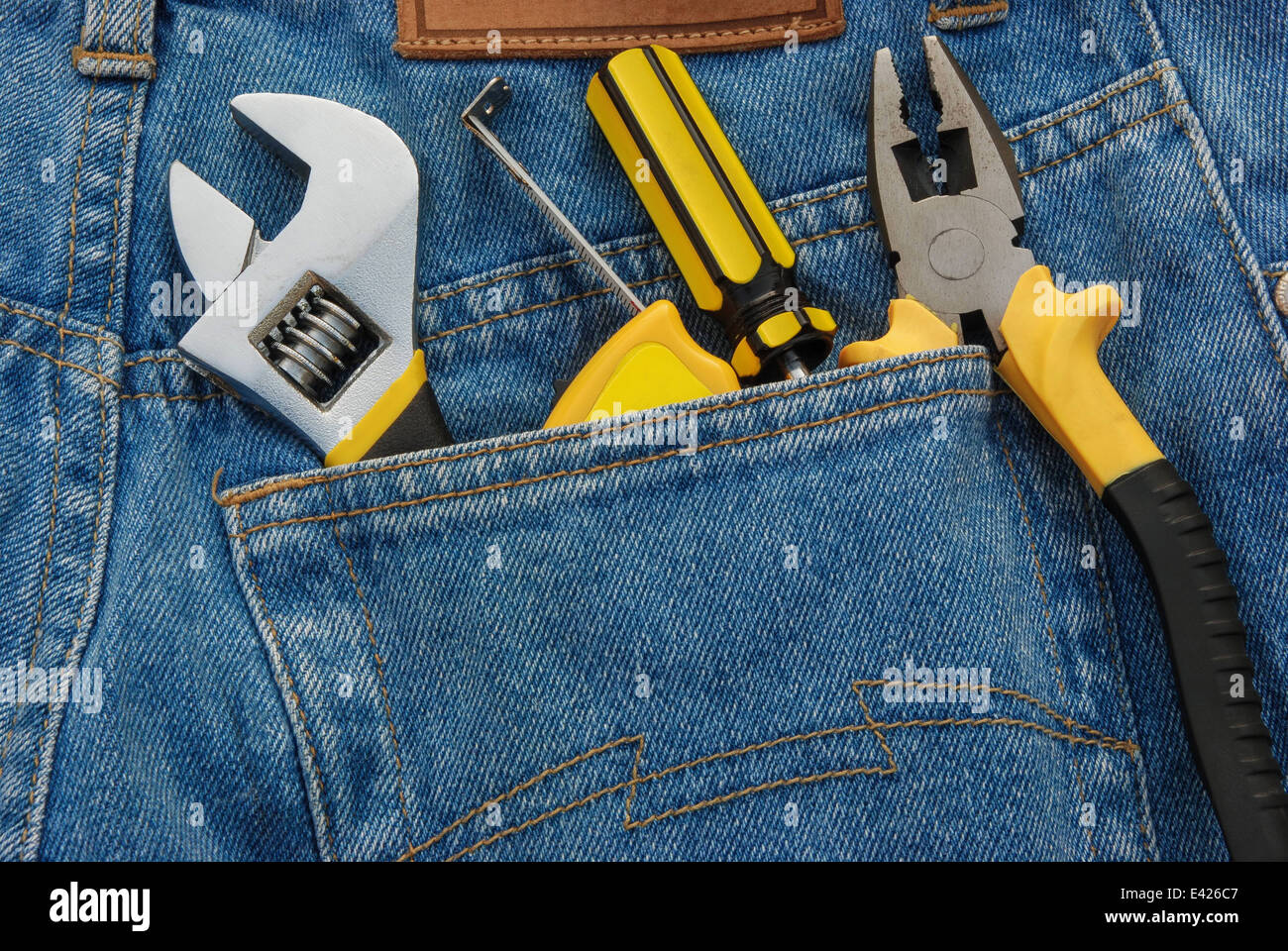 tools in a blue jean back pocket - Stock Image