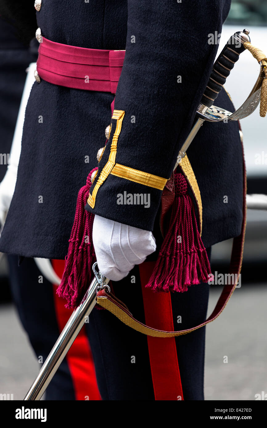 Officer in the British Army in ceremonial uniform standing to attention and carrying his sword of office, Glasgow, - Stock Image