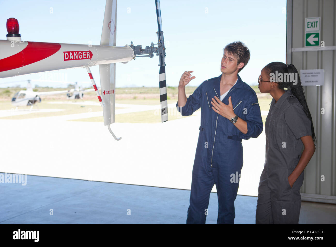 Student pilots sharing helicopter knowledge - Stock Image