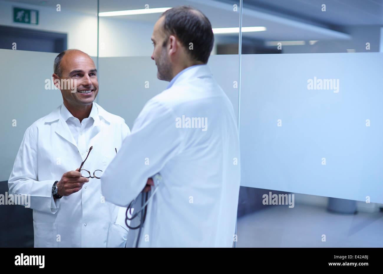 Doctors taking break in office - Stock Image