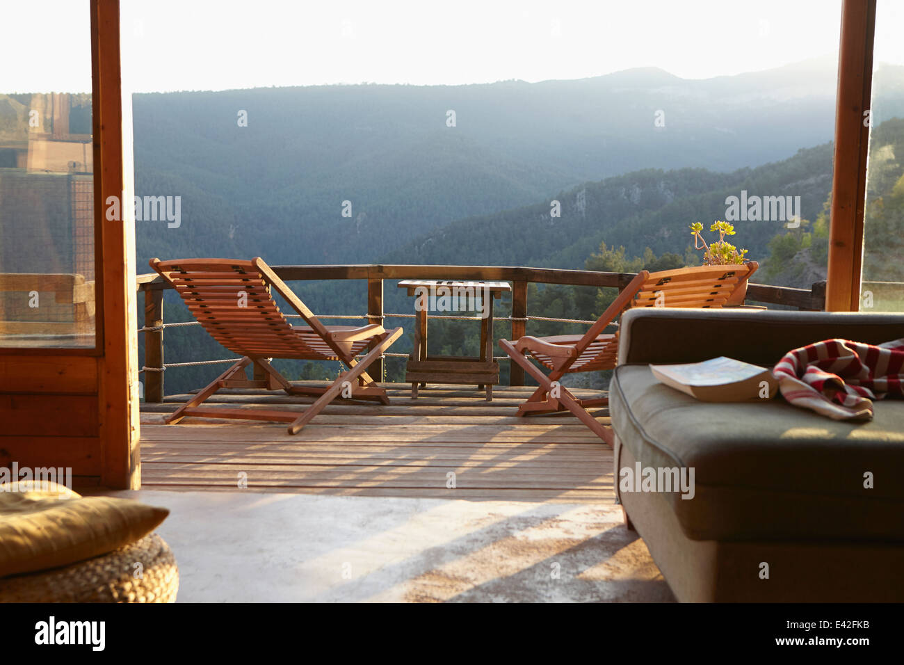 View from sitting room onto sunlit rural balcony - Stock Image