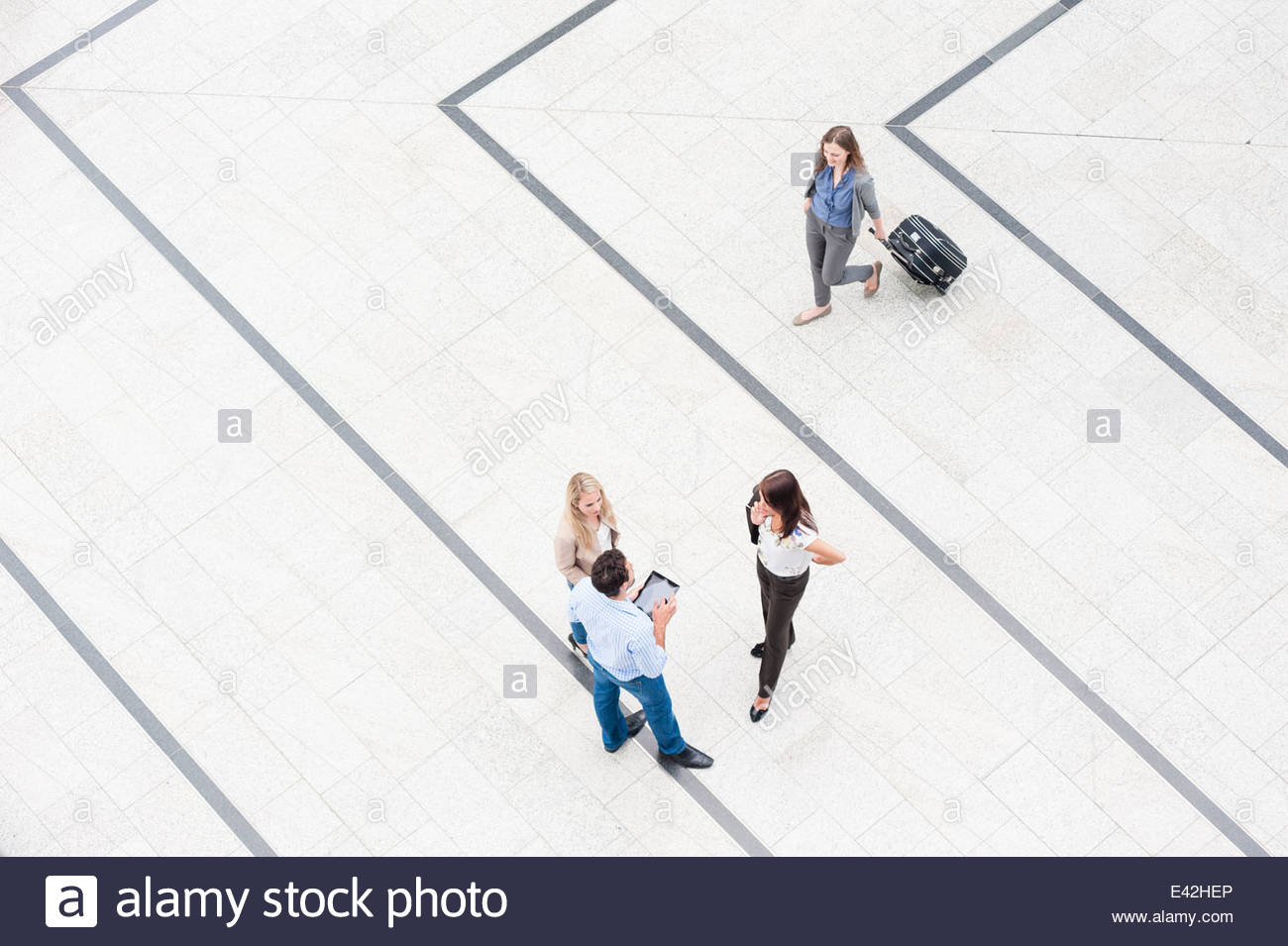 Four people in concourse, high angle - Stock Image