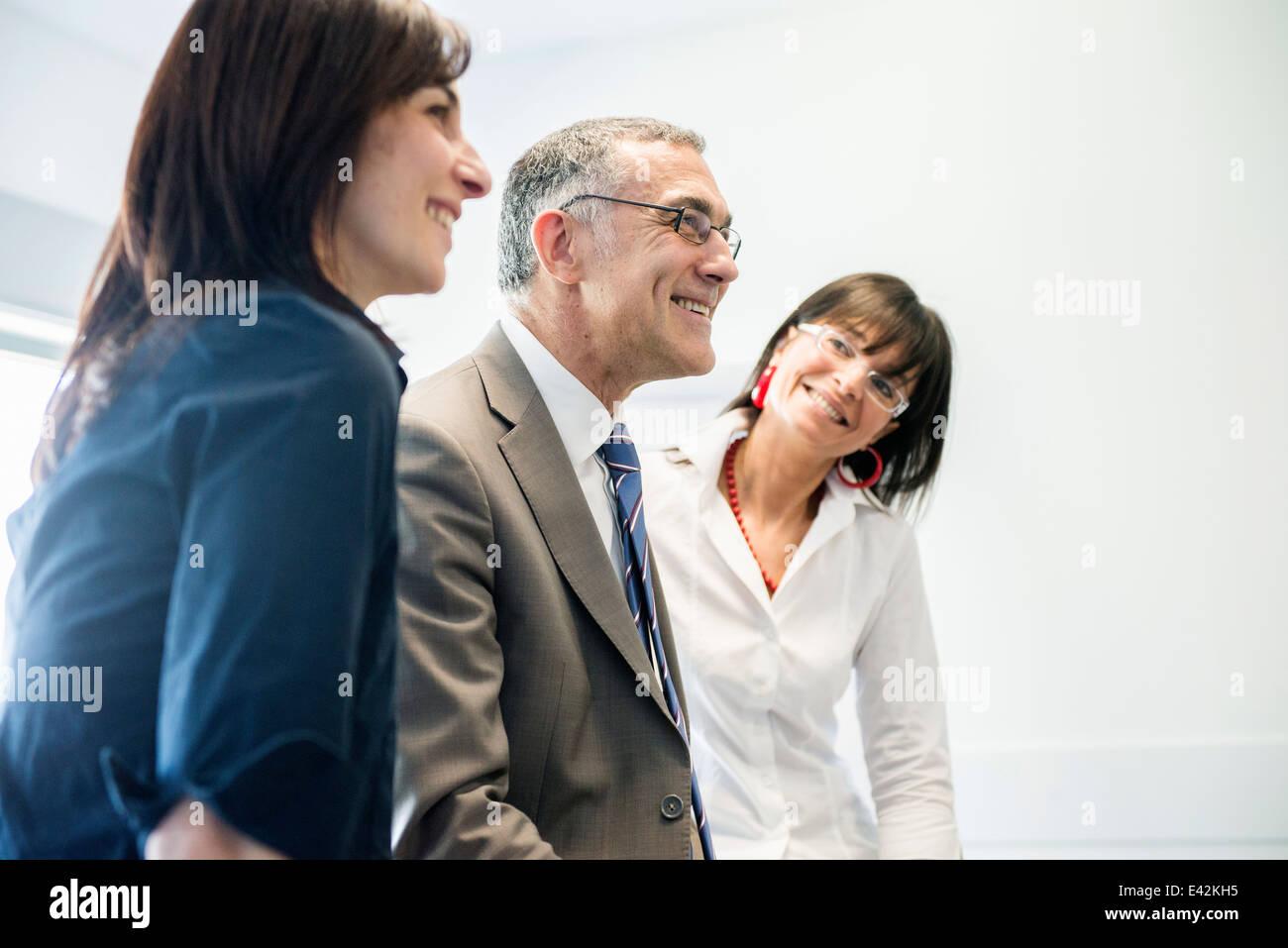 Businessman and women taking break - Stock Image