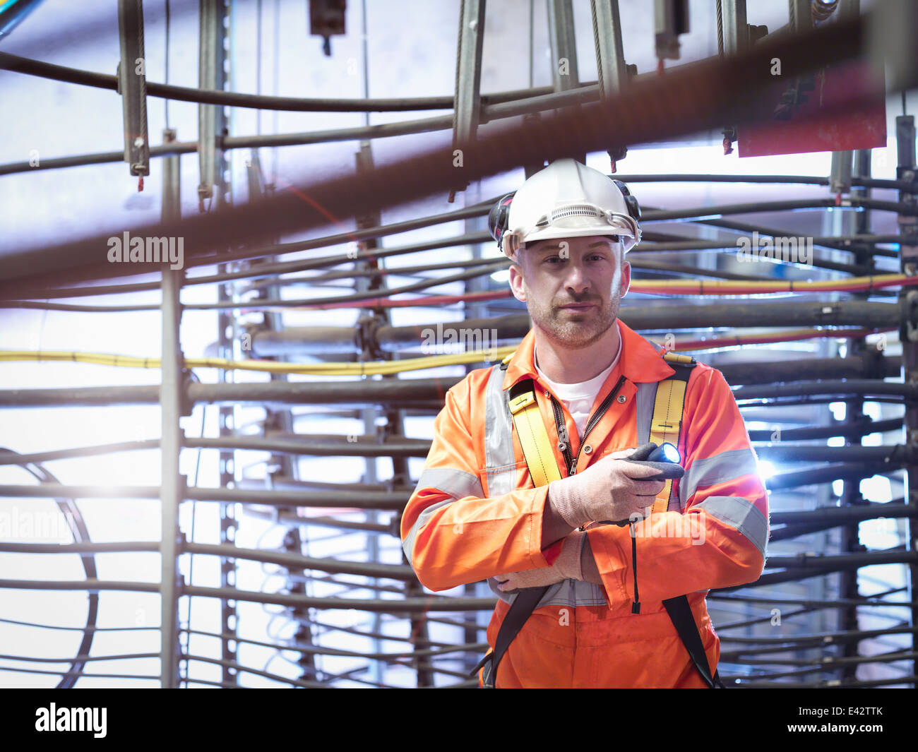 Engineer inspecting cable expansion in suspension bridge, portrait. The Humber Bridge, UK, built in 1981 - Stock Image