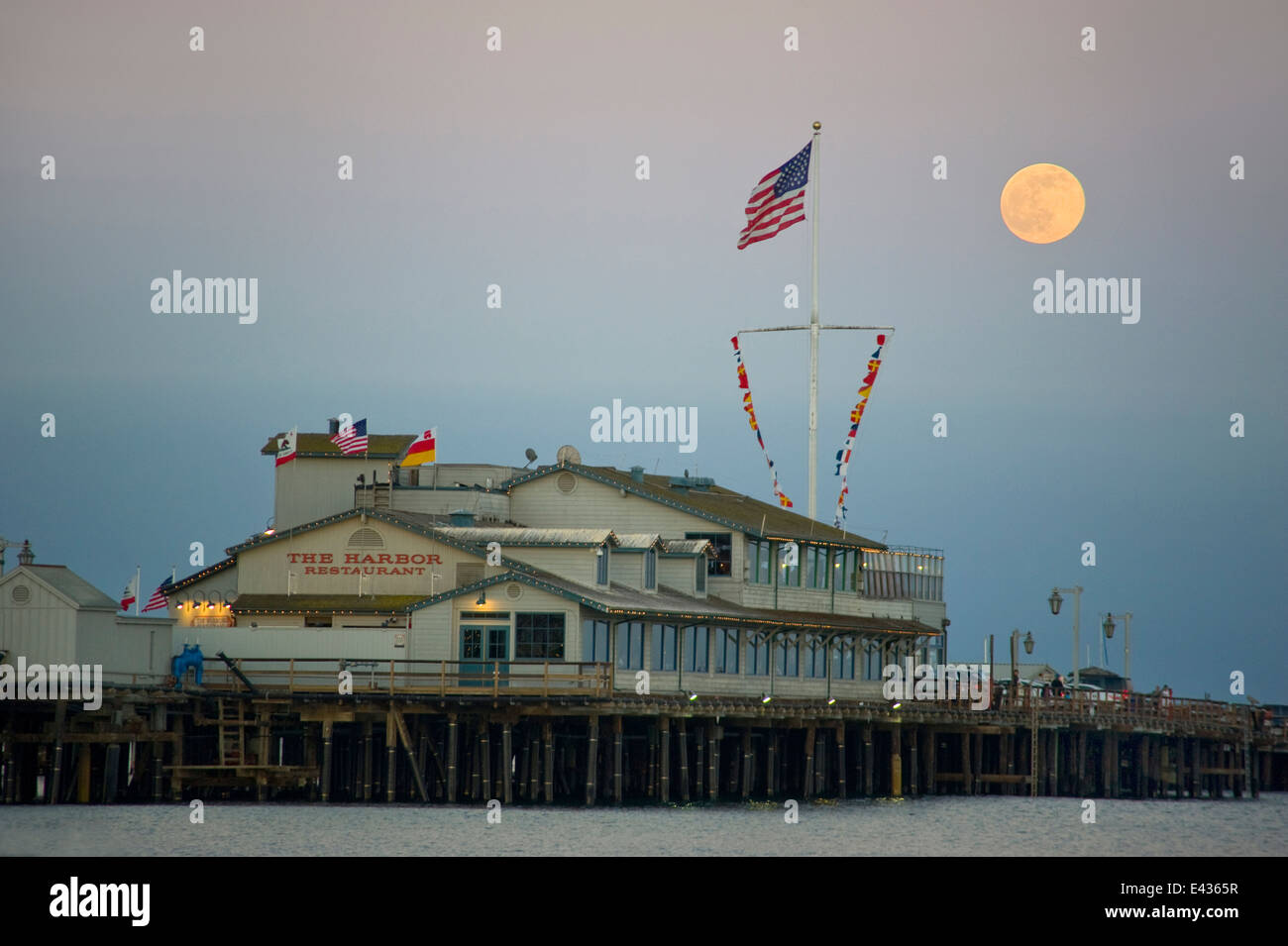 Full moon over pier in Santa Barbara, CA - Stock Image
