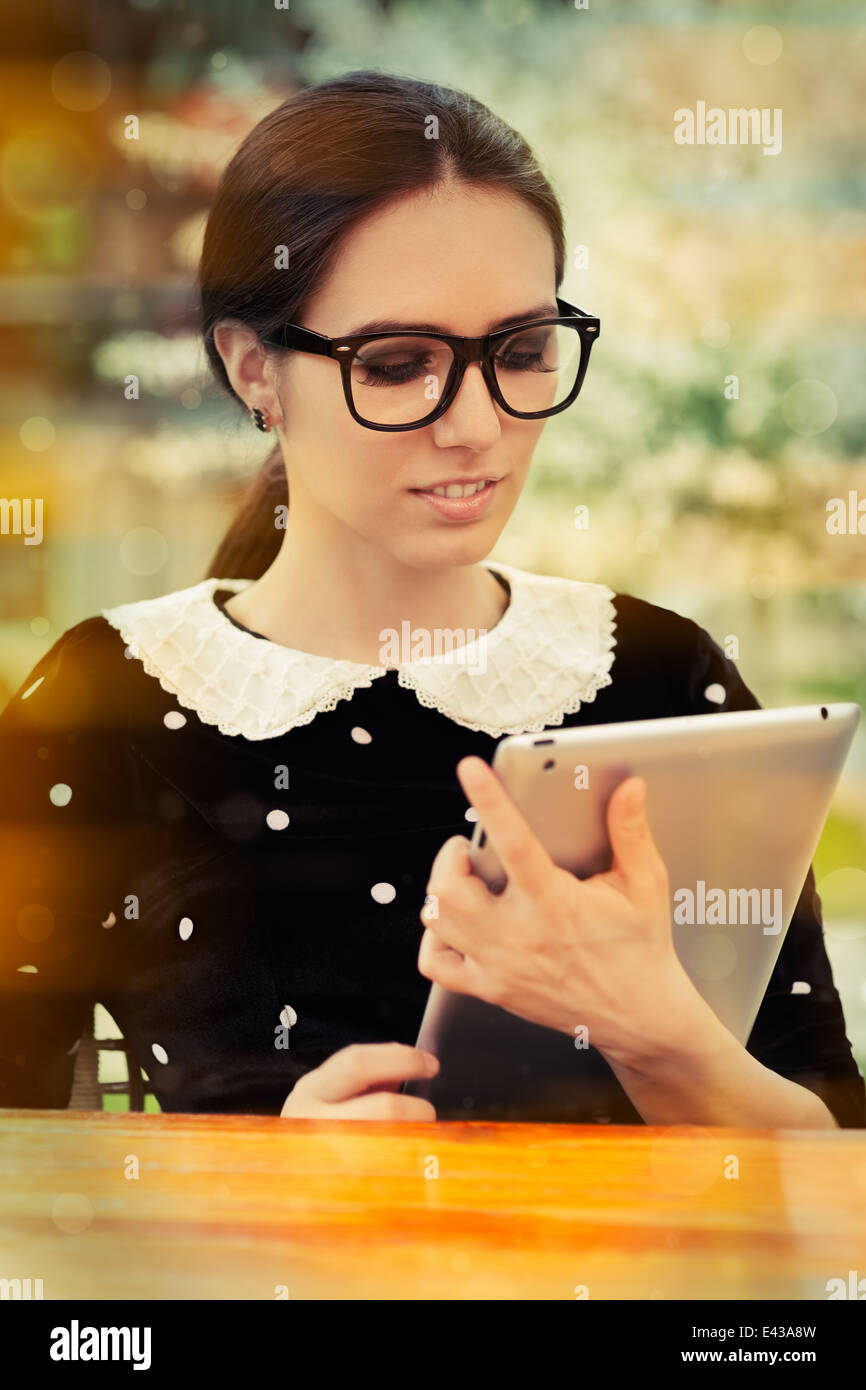 Young Woman with Glasses and Tablet - Stock Image