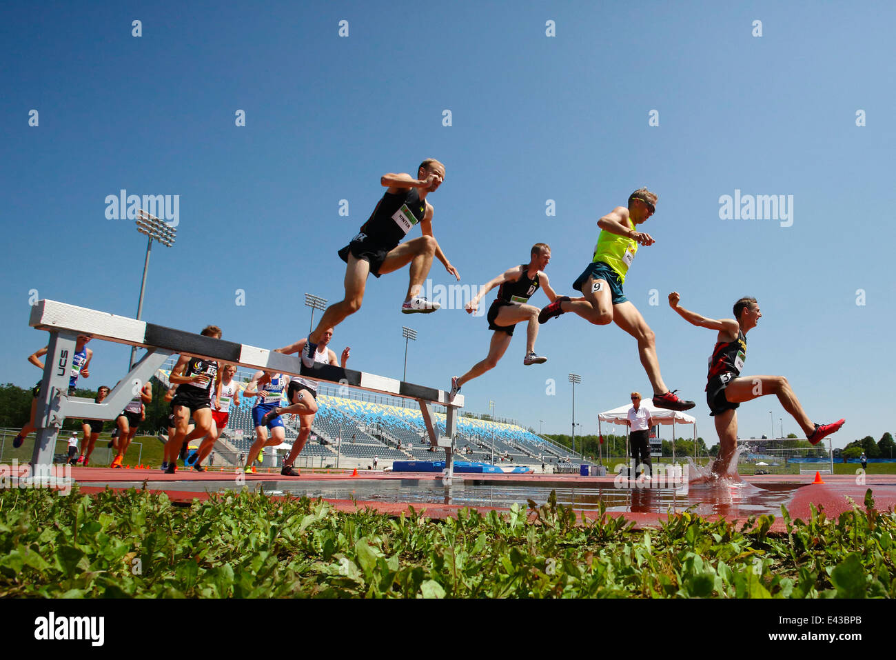 Competitors in the men's 3000-meter steeplechase at the Canadian Track & Field Championships June 28, 2014 in Moncton. Stock Photo