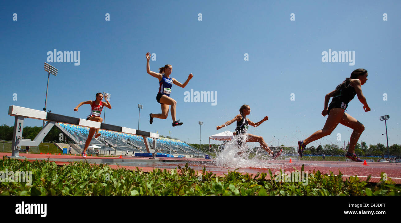 Competitors in the women's 3000-meter steeplechase at the Canadian Track & Field Championships June 28, 2014 in Stock Photo