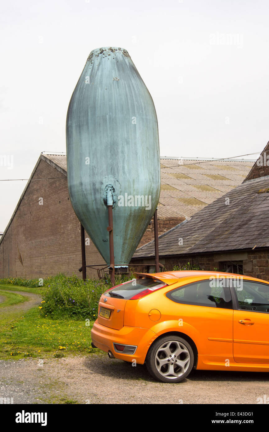 An old grain hopper on a farm in the Eden Valley, Cumbrias, UK, at Holmwrangle. Stock Photo