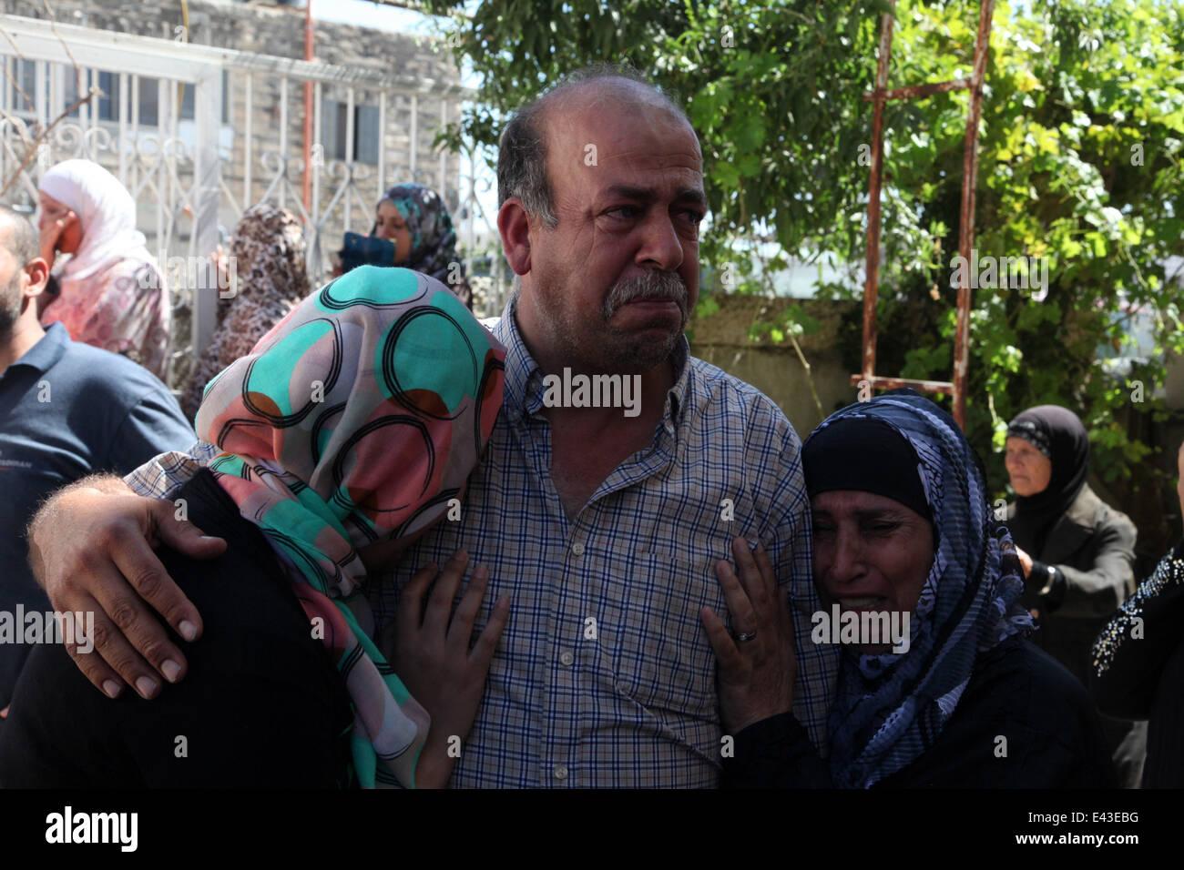 July 2, 2014 - Shuafat, Jerusalem - Relatives of Mohammed Abu Khudair, mourn in Shuafat, an Arab suburb of Jerusalem. - Stock Image