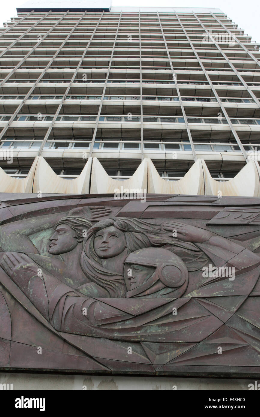 A bas relief sculpture featuring a cosmonaut on a building near Alexanderplatz in Berlin, Germany. - Stock Image