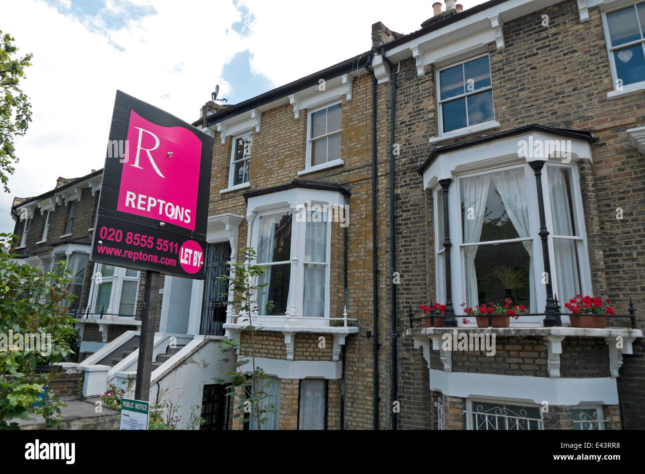 Reptons Estate Agent sign outside a newly refurbished home in Shacklewell Lane Dalston Hackney East London E8  KATHY - Stock Image