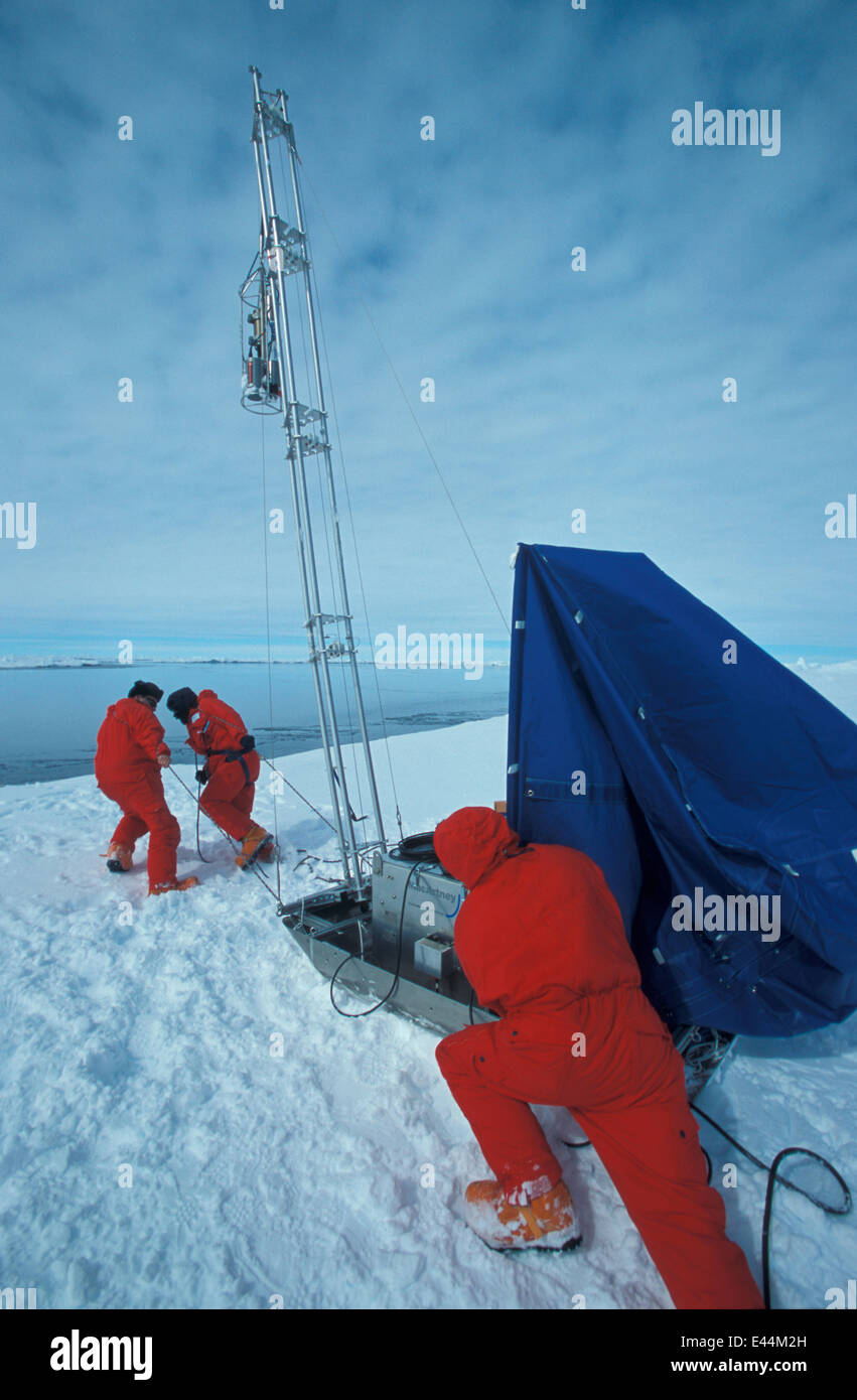 'CTD' (instrument for collecting water samples from all water depths) at work 50 km from the ice floe base. - Stock Image
