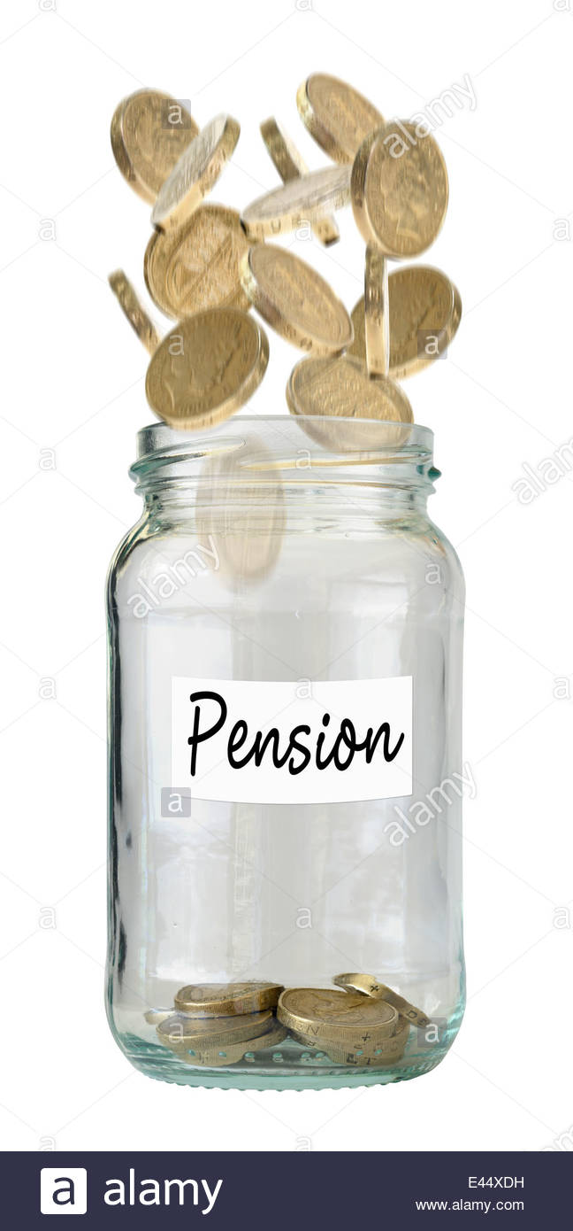British One Pound coins falling into savings jar for a pension, Dorset, England, UK - Stock Image