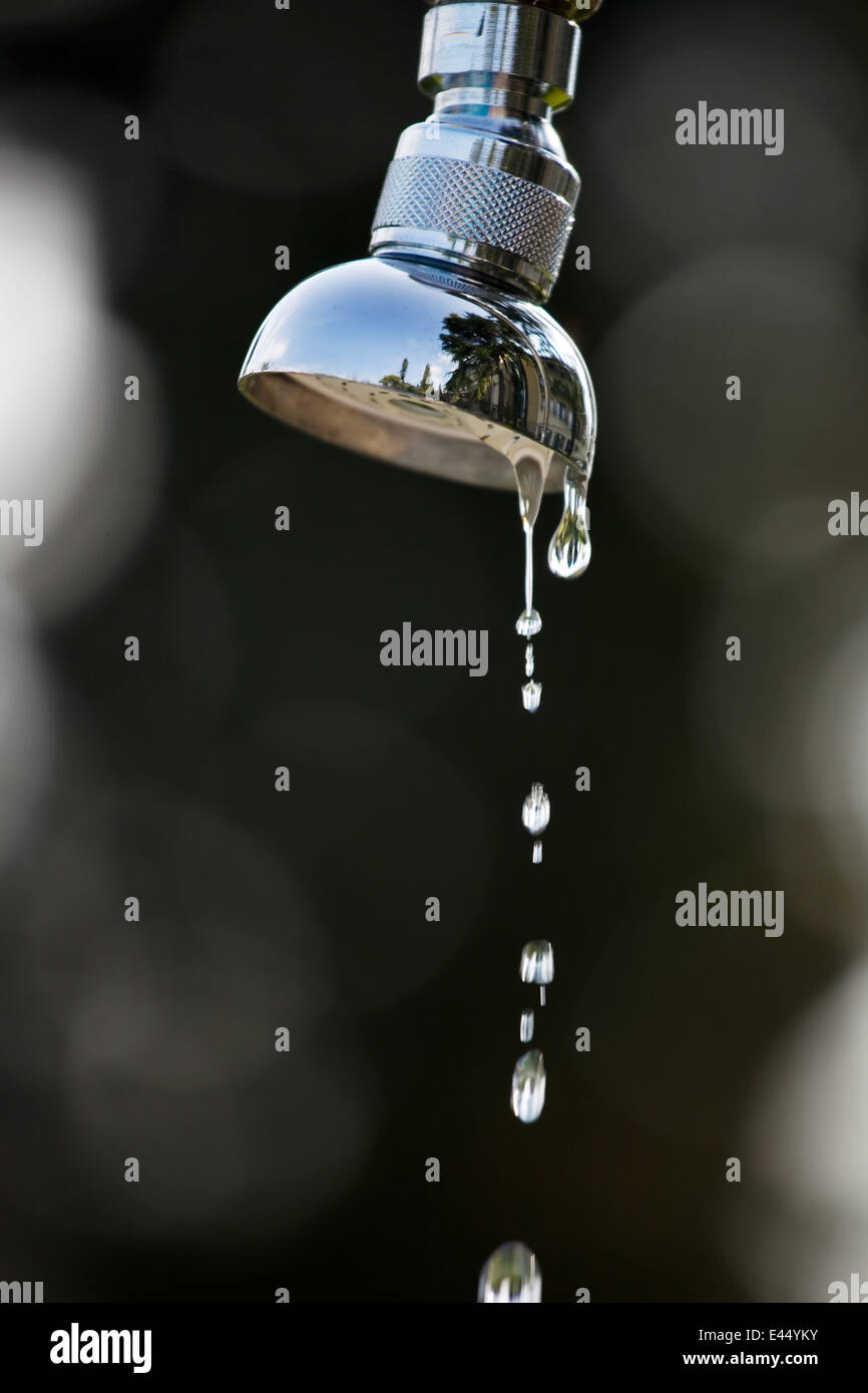The water drops of a shower. Shower stands in the garden Stock Photo ...