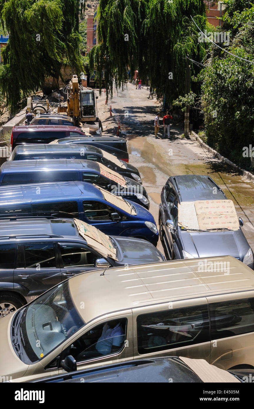 Cardboard over the window of a car to keep out the heat in Morocco. - Stock Image