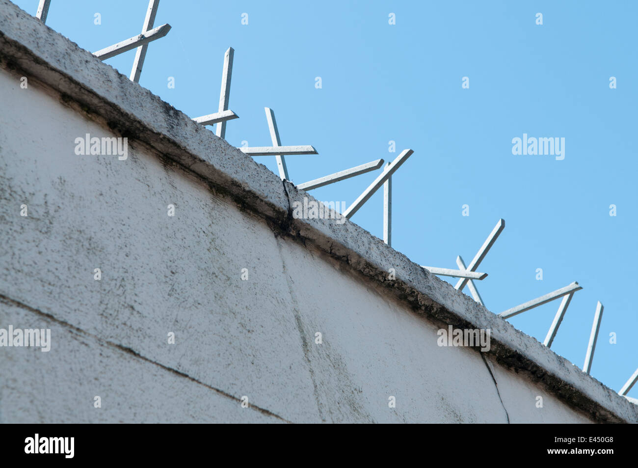 Security spikes on top of a wall. - Stock Image
