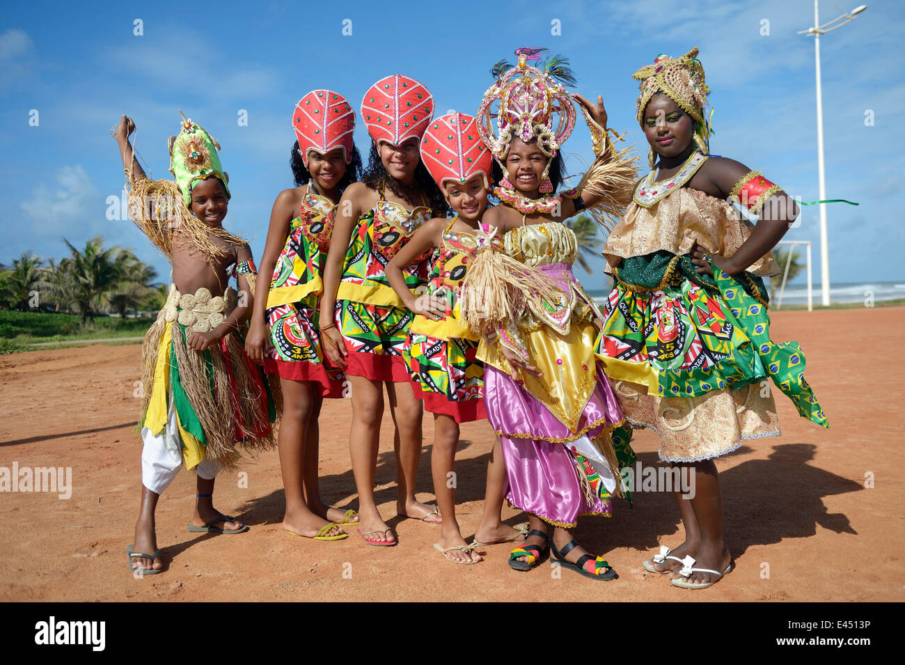 Colourfully dressed children of a traditional Afro-Brazilian musical group, Salvador da Bahia, Bahia, Brazil - Stock Image
