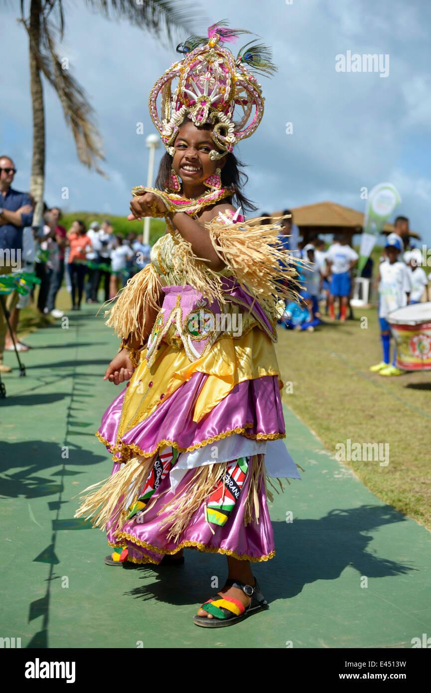 Dancer, lydressed girl of a traditional Afro-Brazilian musical group, Salvador da Bahia, Bahia, Brazil - Stock Image