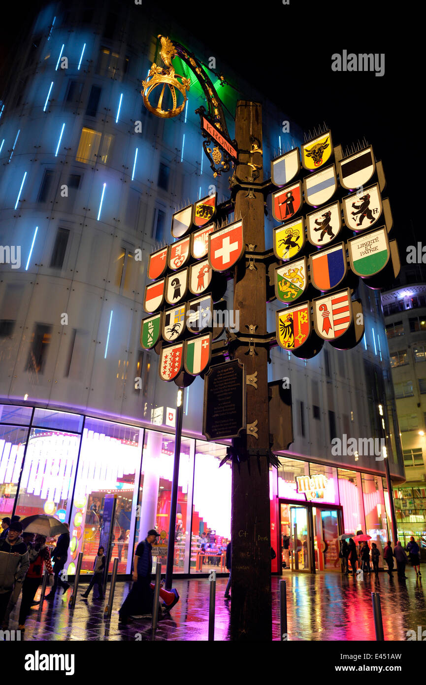 Swiss cantonal coats of arms on Leicester Square, at night, London, England, United Kingdom - Stock Image