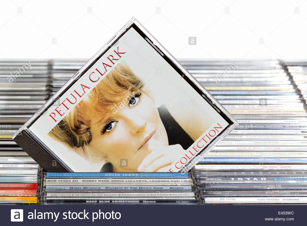 Petula Clark Ultimate Collection album, piled music CD cases, England - Stock Image