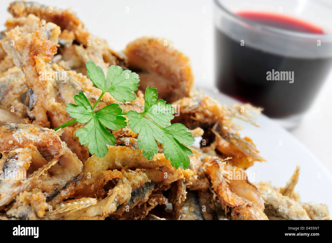 a plate with some spanish boquerones fritos, fried anchovies typical in Spain, served as tapas - Stock Image