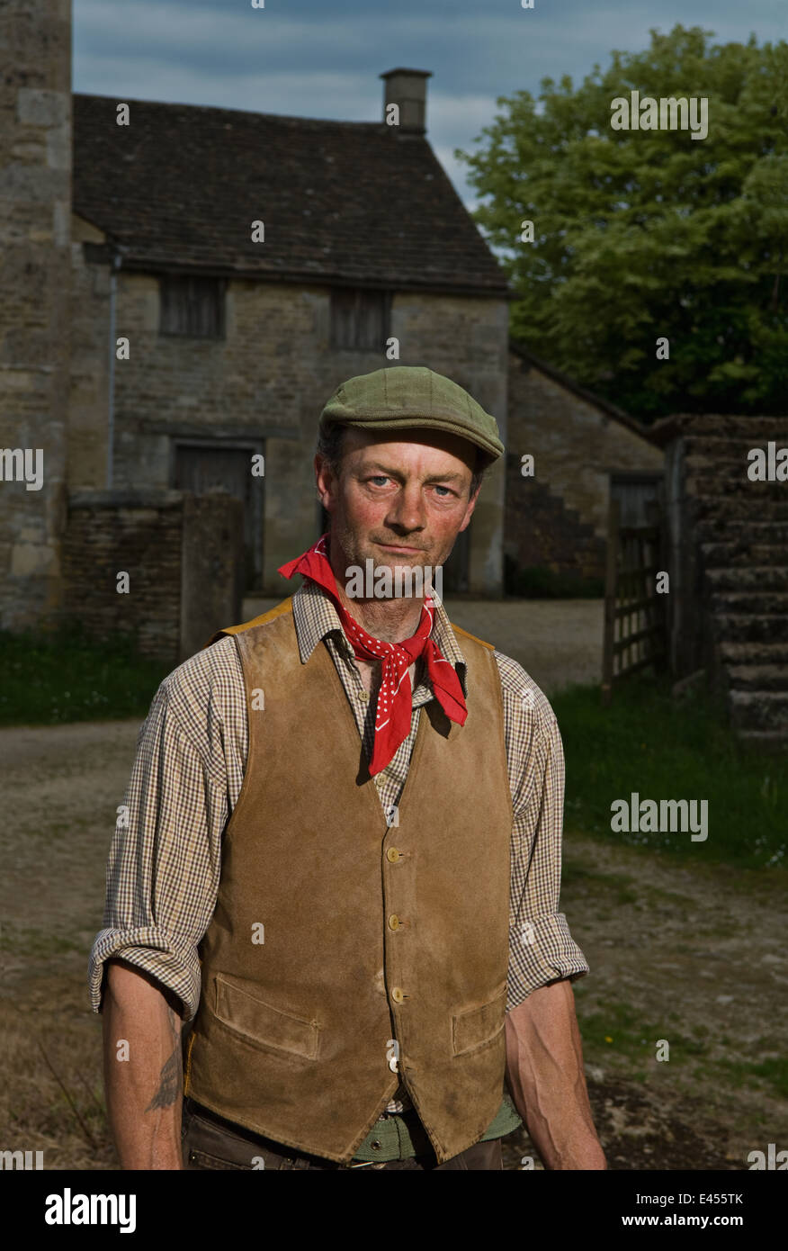Portrait of mature traditional farmer in farmyard - Stock Image