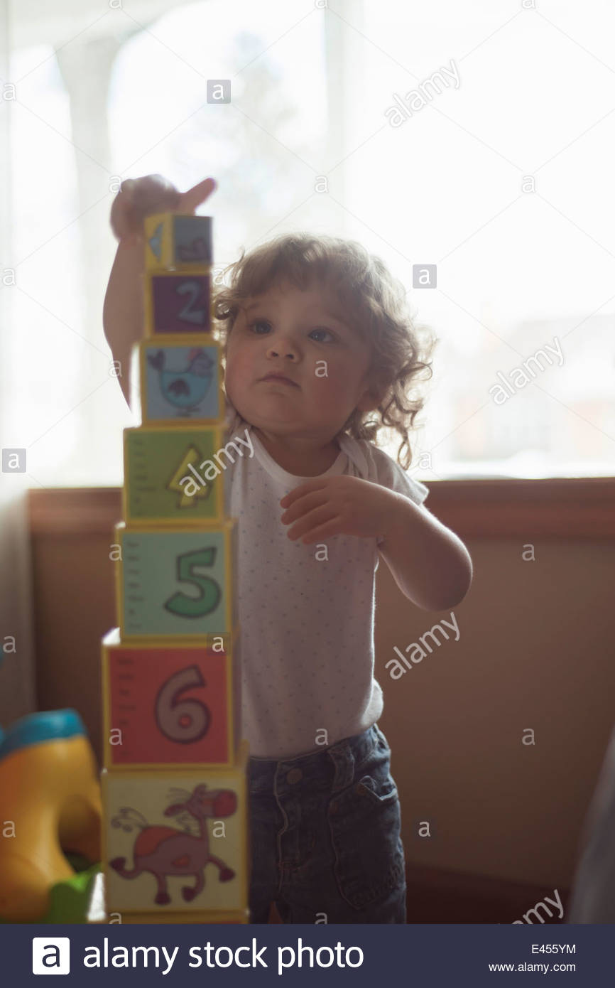 Toddler playing with building blocks - Stock Image