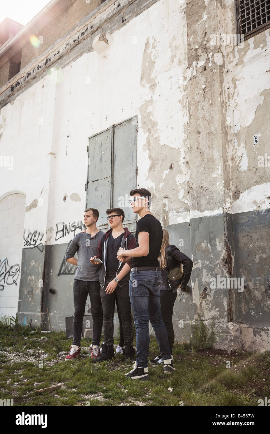 Teenagers hanging out at abandoned building - Stock Image