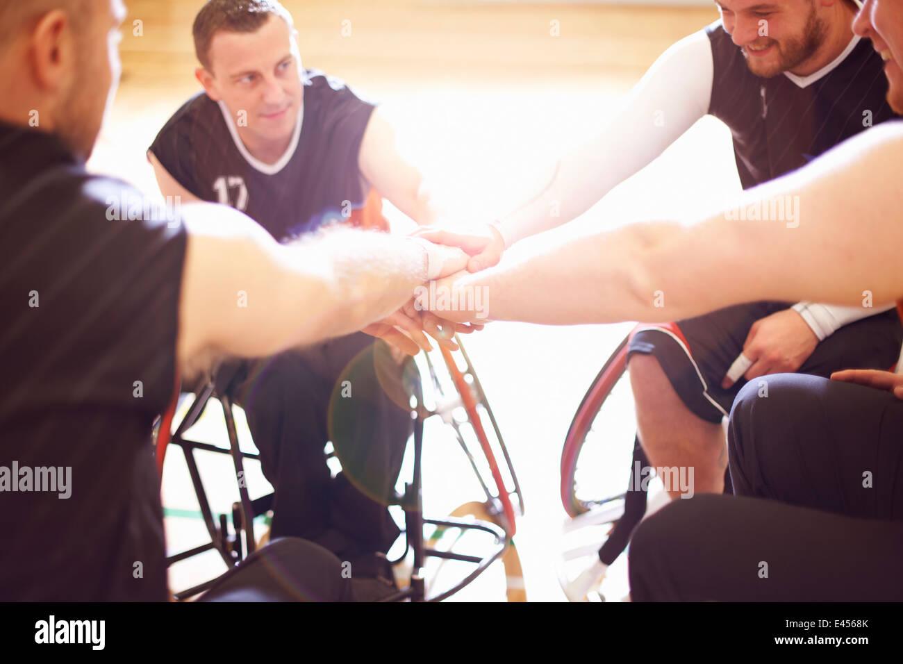 Wheelchair basketball players display team encouragement - Stock Image