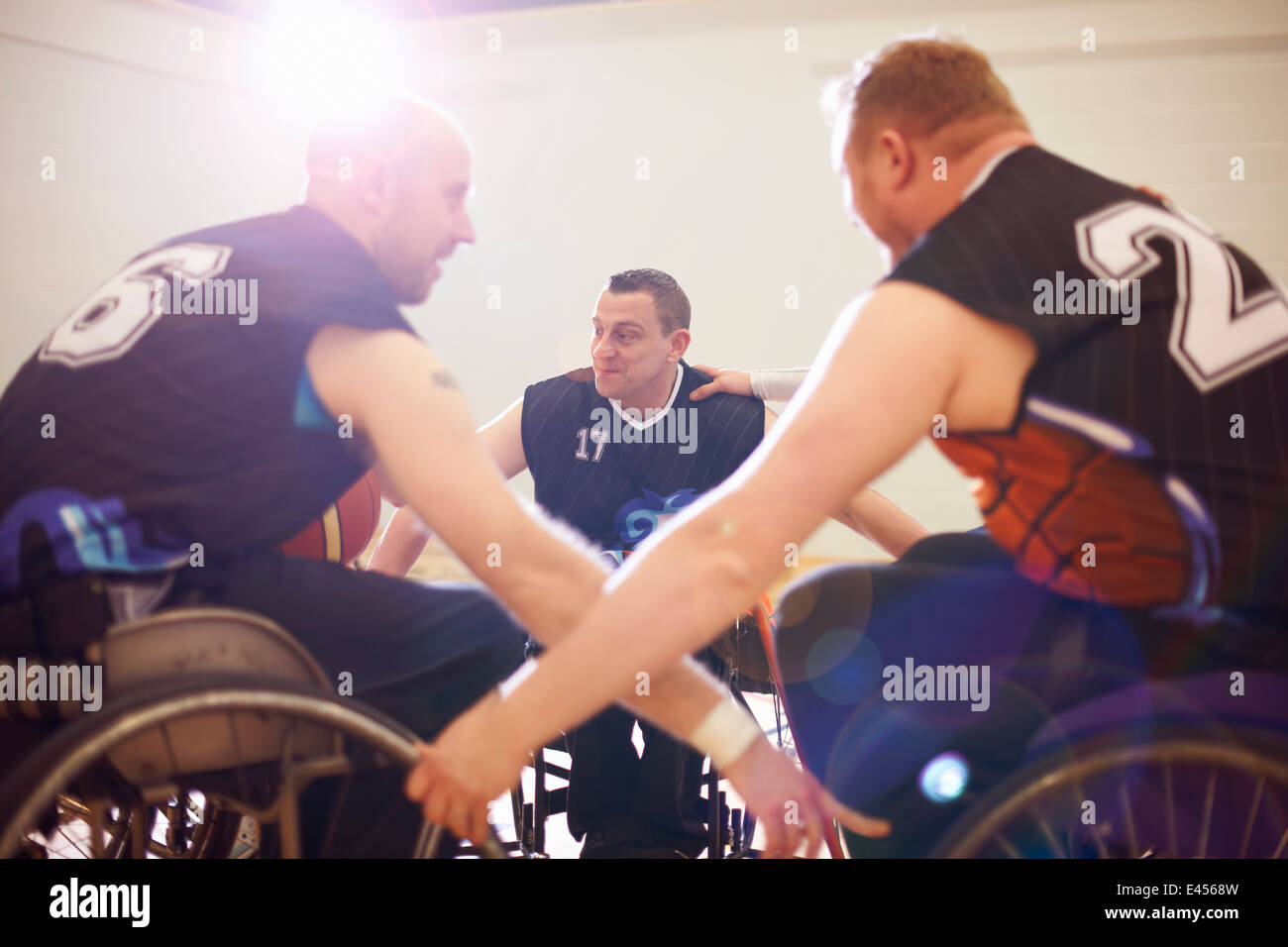 Wheelchair basketball players display team encouragement - Stock Image