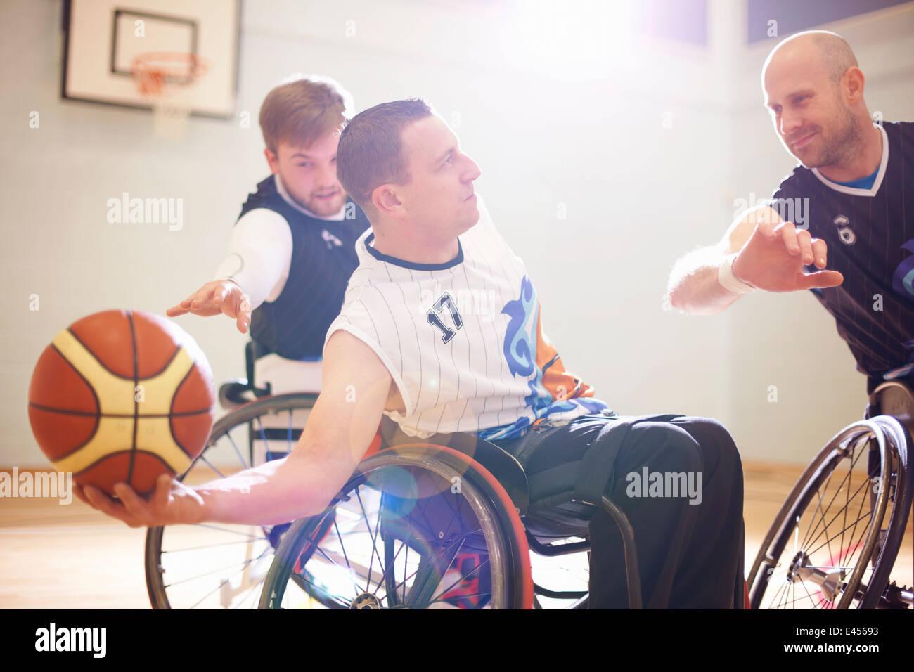 Wheelchair basketball players playing basketball - Stock Image