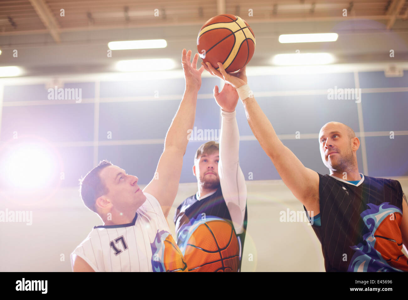Wheelchair basketball players playing basketball - Stock Image